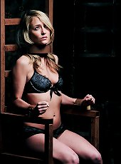 Cute blonde sitting on a rusty iron chair | Shac..